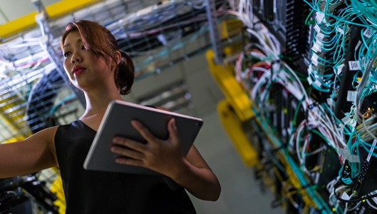 Woman standing in data center